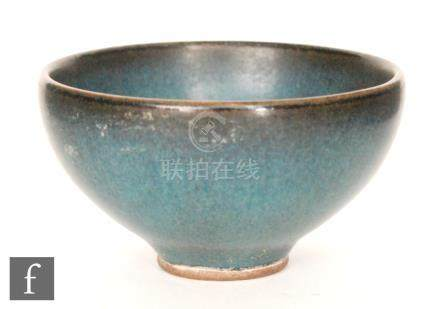 A Chinese Song Junyao style bowl, the 'U' form bowl rising from an unglazed low footring,