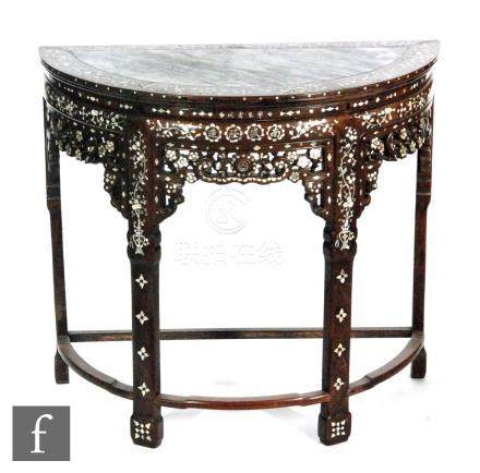 An early 20th Century Chinese export hardwood console table of demi-lune form,