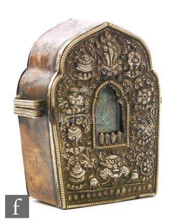 A late 19th/early 20th Century Tibetan white metal travelling shrine/prayer box, of Arabesque form,