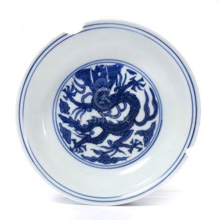 Blue and white saucer dish Chinese, late Ming centrally decorated with a five claw dragon within