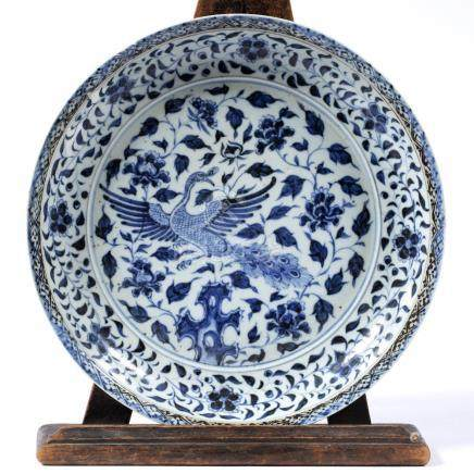 Blue and white dish Chinese decorated with a phoenix in flight 28cm across