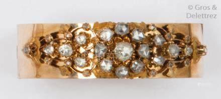 Bracelet rigide ouvrant en or jaune 14K, orné d'un motif central serti de diama