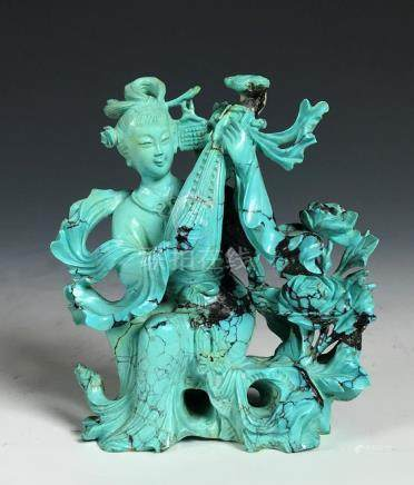A Finely Carved Turquoise Figure