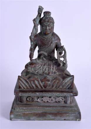 A CHINESE BRONZE FIGURE OF A BUDDHA. 18 cm high.