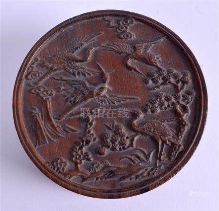 A CHINESE CARVED WOODEN BOX. 11 cm diameter.