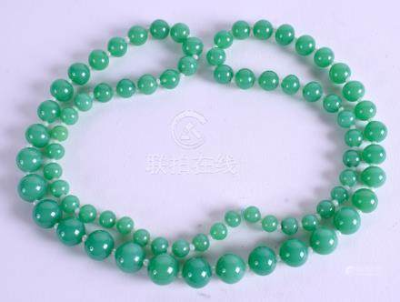 A CHINESE JADEITE NECKLACE. 64 cm long.