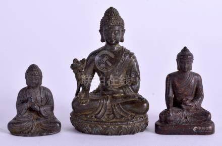 THREE CHINESE BRONZE BUDDHAS. Largest 5 cm high. (3)