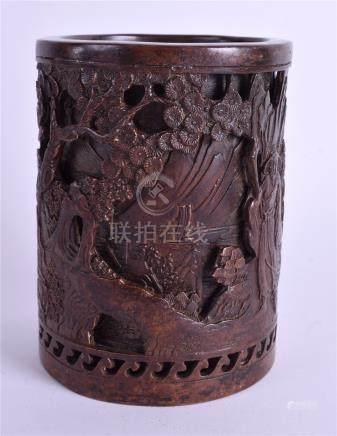 A CHINESE BRONZE BRUSH POT. 14 cm high.