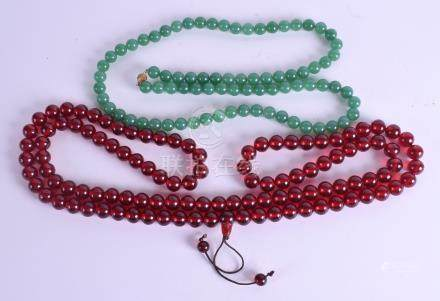 A CHINESE JADEITE NECKLACE together with a cherry amber type necklace. (2)