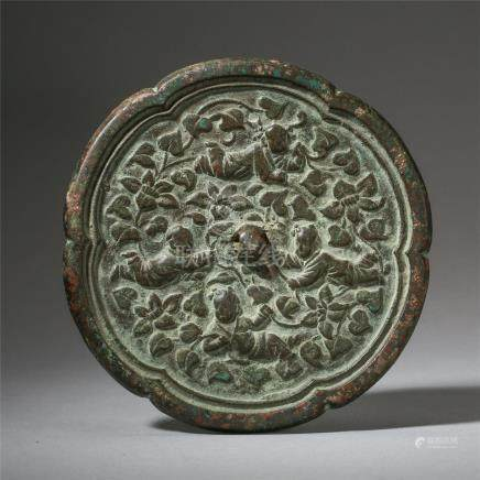 CHINESE BRONZE BOY PLAYING FLOWER SHAPED MIRROR LIAO DYNASTY