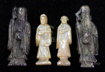 A near pair of Chinese carved mother of pearl standing figures, 19th century, each holding a fan,