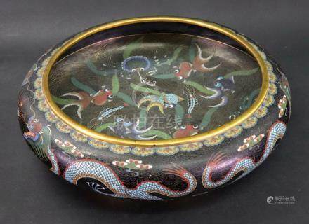 A Chinese cloisonne black ground bowl, circa 1900, of shallow circular form,