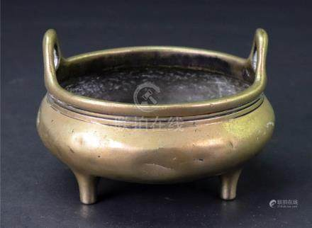 A Small Chinese bronze two handled tripod censer, six character Xuande mark but later,