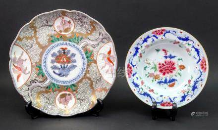 A Chinese famille rose pudding plate, Qianlong, brightly enamelled with flowers,
