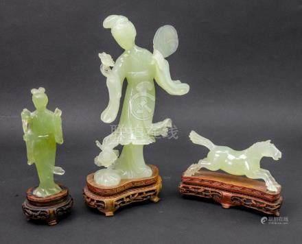 Three Chinese green hardstone figures, 20th century,