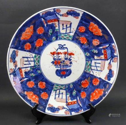 A large Japanese Imari dish, Meiji period, painted with a central basket of flowers,