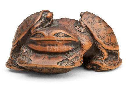 A wood netsuke of terrapins and a frog By Hidetsugu, Edo period (1615-1868), 19th century