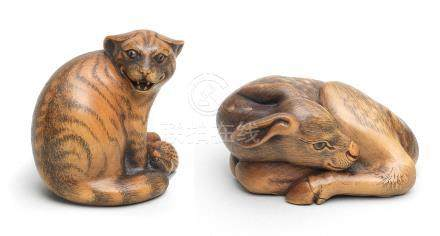 Two boxwood netsuke of a wildcat and a fawn By Jack Coutu (1924-2017), English, the first carved September 1988, the second carved April 1997 (4)