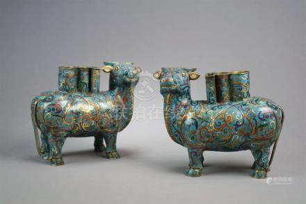 A pair of Chinese cloisonné buffalo vessels