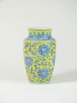 A Chinese porcelain lemon yellow and blue and white vase