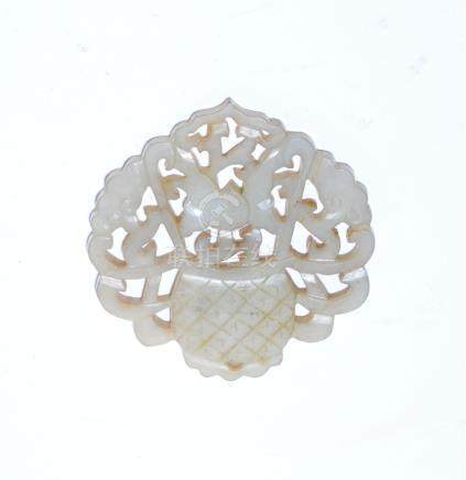 A Chinese pale green jade openwork plaque