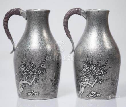 Two Chinese Silver Blossom Jugs with Braided Handle