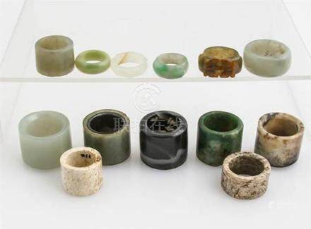 Thirteen Chinese Jade and Hardstone Archer's Thumb Rings and