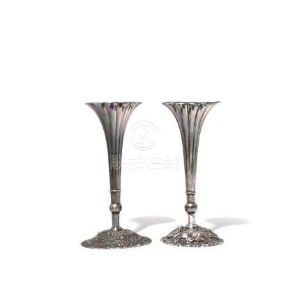 A NEAR PAIR OF JAPANESE SILVER VASES