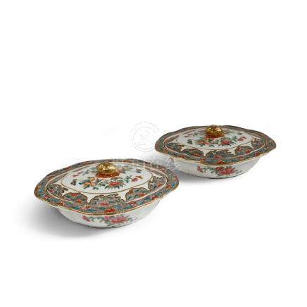 A PAIR OF CHINESE FAMILLE ROSE TUREENS AND COVERS