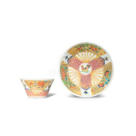 A CHINESE FAMILLE ROSE GILT-DECORATED TEA BOWL AND SAUCER