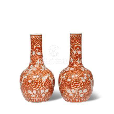 A PAIR OF CHINESE IRON RED-GROUND 'PHOENIX' BOTTLE VASES