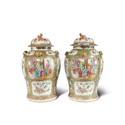 A PAIR OF CHINESE CANTON FAMILLE ROSE BALUSTER VASES AND COVERS