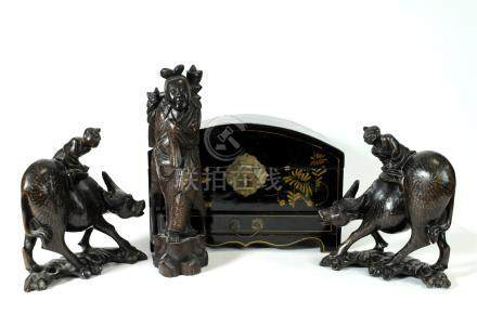 A pair of early 20th century Chinese carved hardwood groups of figures riding water buffalo