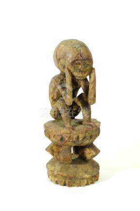 A small late 19th century or later central African carved wooden figure