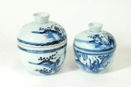 Two similar graduating 19th century Chinese blue and white porcelain jars and covers