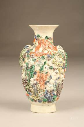 20th Century Chinese vase, baluster form decorated with figures and a dragon in relief. Incised seal