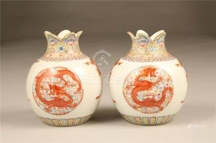 Pair 20th Century Chinese vases, spherical form, with lobed rims, decorated with iron red dragons,