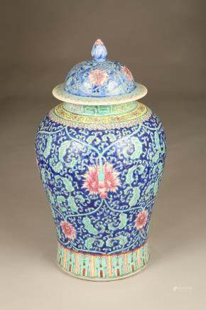 A large 20th Century Chinese vase and cover, baluster form, blue ground with floral and foliate