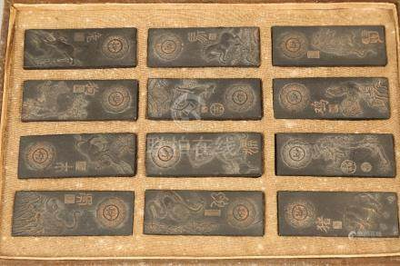Boxed set of twelve Chinese carved hardwood plaques, depicting each of the signs of the zodiac. 78mm