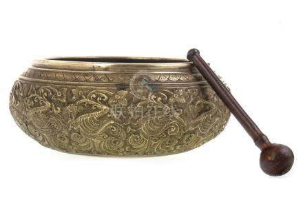 A CHINESE BRASS RINGING BOWL