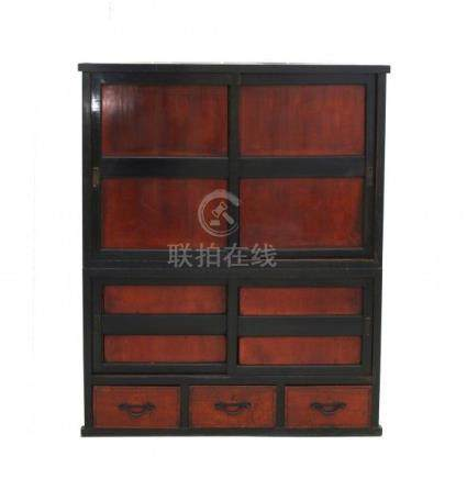 A Japanese cabinet 'tansu', the front with sliding doors and three drawers. Meiji period (1868-