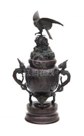 A Japanese bronze koro, with dragon shaped handles and crowned with a phoenix on a rock. 20th