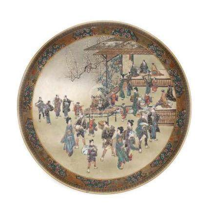 A Japanese Satsuma plate, decorated with a busy market square. With three character mark Kinkozan,