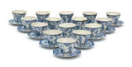 A set of fifteen octagonal Japanese blue and white cup and saucers, decorated with alternating