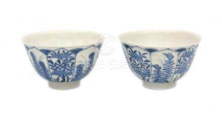A pair of Japanese Arita bowls, decorated with flowers in petal shaped panels. Marked with six