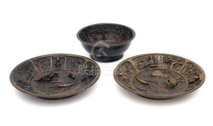 A set of of two bronze plates and a bowl, decorated in high relief with fish, crab and shrimp and
