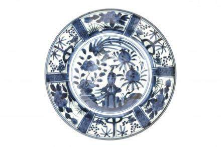 A Japanese blue and white Arita dish, decorated with phoenix and pommegranate. Edo period (1603-