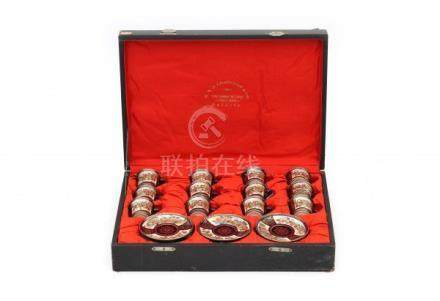 A Satsuma mocca set in a case, comprising of twelve cup and saucers. The case with adres: K.A.J.