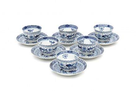 A set of six Chinese blue and white cup and saucers, decorated with sturgeon and carp. Marked with