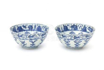 A pair of Chinese blue and white bowls, decorated on the inside with a chakra pattern below a